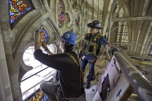Master craftsman Todd Allen and foreman Anthony Del Orbe install a restored stained-glass panel at St. Patrick's Cathedral. Posted in Member News.