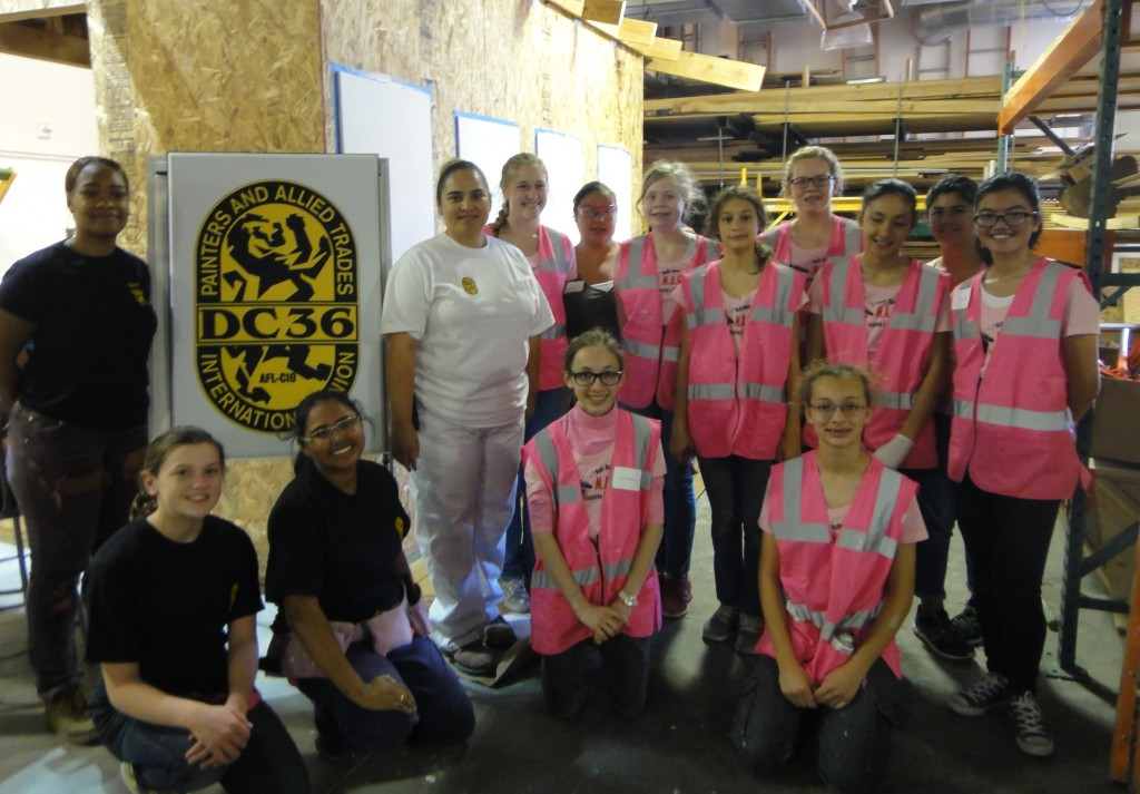 Janet Pineda of IUPAT Local Union 1136 (in whites) with MAGIC participants.