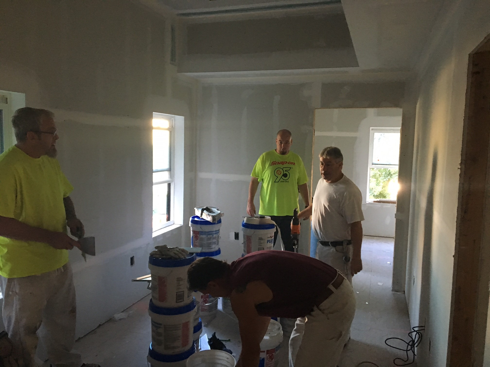 Members of District Council 711 preparing materials for drywall finishing at Project Haven.
