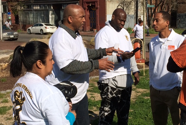 IUPAT General President Kenneth Rigmaiden (second from left) speaking with community leaders at the IUPAT Community Day of Action in Baltimore on April 16, 2016.